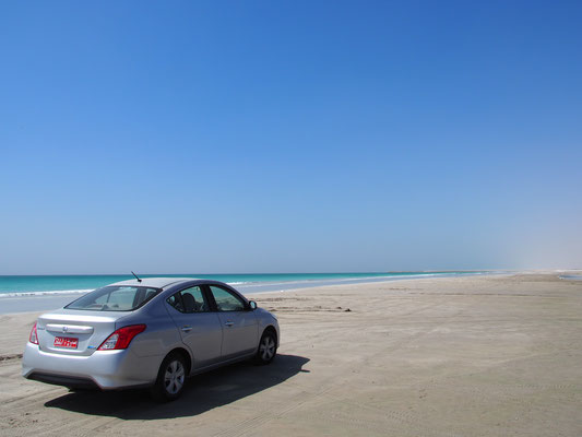Nissan Sunny on the white sandy beach of Salalah.