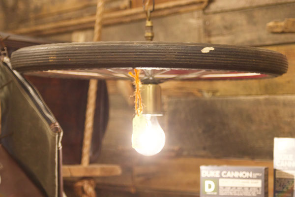 bicycle bike antique vintage wheel light edison bulb refinished shops repurposed lighting different unique one of a kind small business local repurposed chester NJ American New Jersey andover