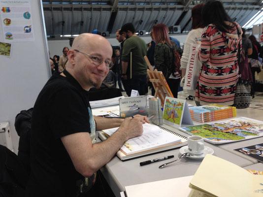 Dino signiert brav Kinderbücher für seine kleinen Fans