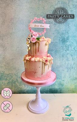 2 laags dripcake roze en wit en goud