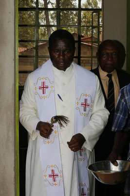 The Catholic priest while blessing...
