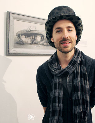the artist Kristian Adam, his paintings, and ixie darkonn's hat. picture by Nina Pak