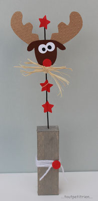 Bricolage enfants Noël. Renne en papier cartonné fixé sur un fil de fer. www.toutpetitrien.ch/bricos/ - fleurysylvie