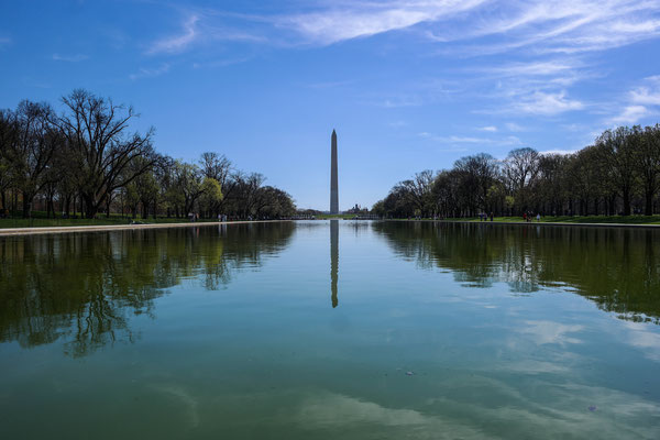 The Washington Monument viewed from over a lake