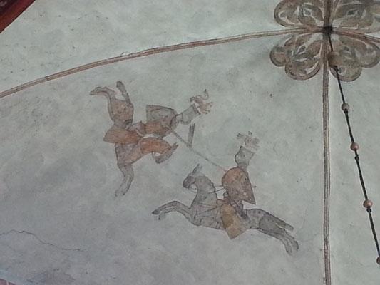 Ein Reiter trägt auf dem Schild einen Löwen ,der andere einen Adler. Die selbigen als Zemier auf den Helmen