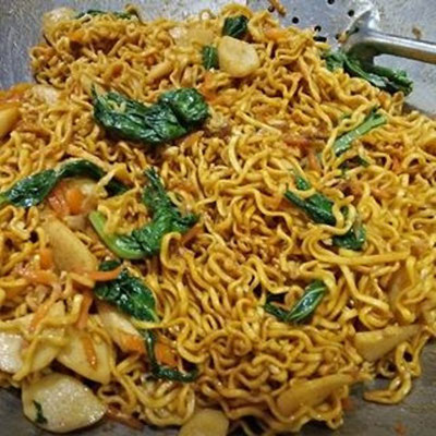 Stir-fried noodles with vegetables, fish or chicken - mixed with a range of spices, such as garlic, tamarind and chili as well as sweet soy sauce - perhaps one of the main dishes that define Balinese and Indonesian cuisine.