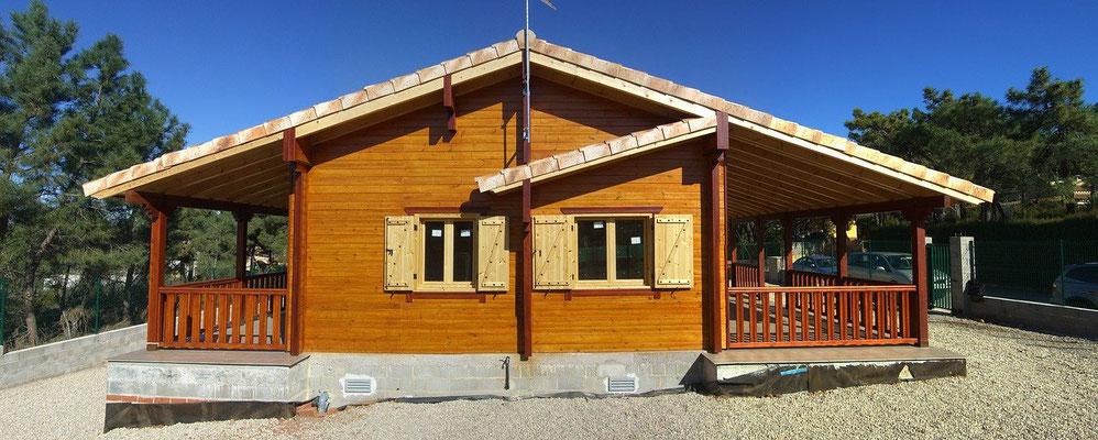 Holzhaus in Ständerbauweise mit Blockhausoptik
