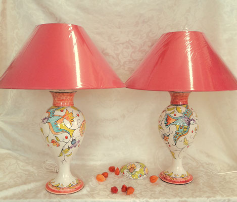 Large curvy lamps with bird decorations inh a Kasmir style. Unique pieces for a sitting room.