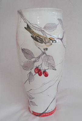 Tall vase with a bird in an Earl Grey pattern.