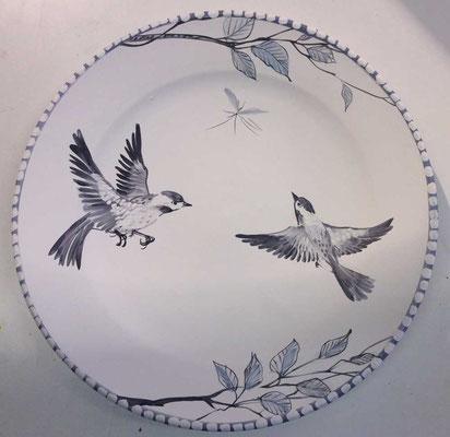 Plat oiseaux en noir et blanc.