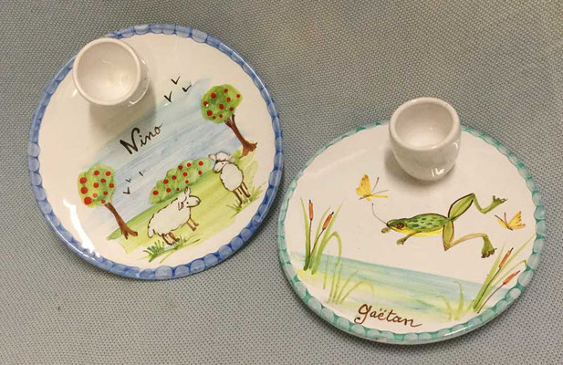 Egg cups, sheep and frog patterns.