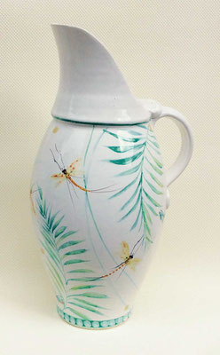 Large pitcher with may fly decoration.