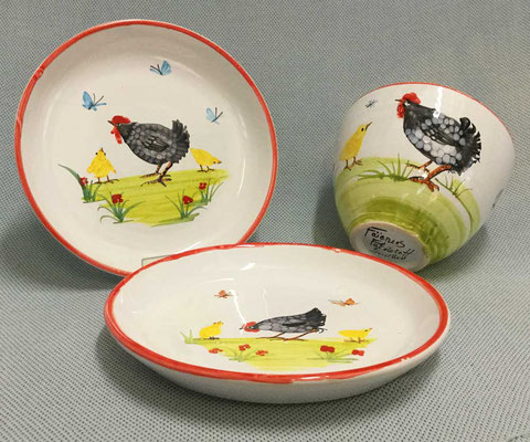 Plates and small bowl, black Quercy chicken pattern.