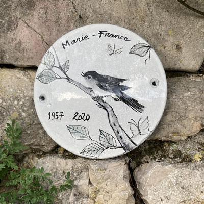 Round lava cemetery plaque, 18cm diameter.