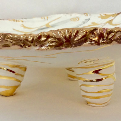 Detail flat dish with three feet. Grey, pearl and gold decoration.