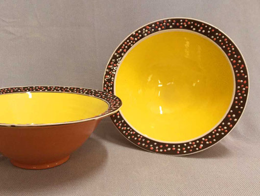 Large salad bowls, yellow slip pattern.