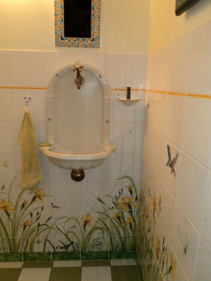 Wall tiles made to measure in a yellow iris pattern.