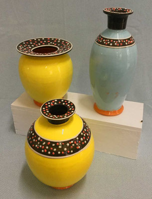 Bottles and vase, yellow and blue slip pattern.