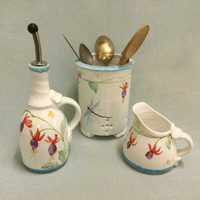 Oil pourer, cutlery drainer and cream jug.