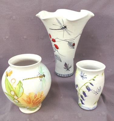 Vase corolle, vase rond et petit vase.