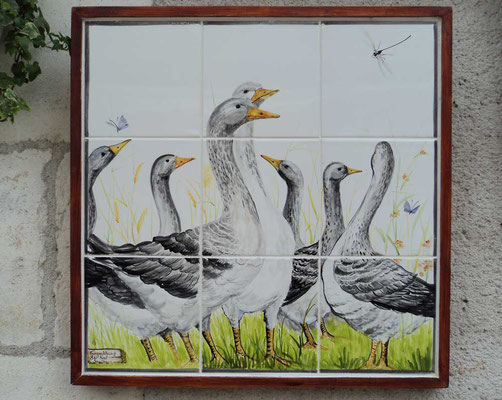 Framed picture of geese.