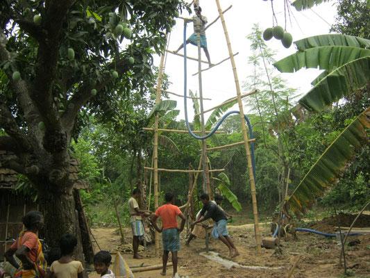 Starting the hand pump installation at Dhamua village