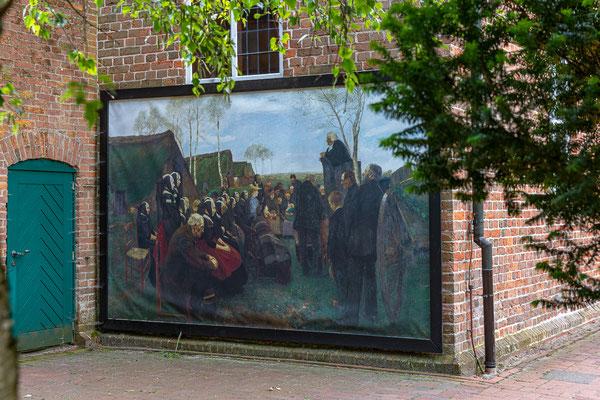 """Das Gemälde """"Gottesdienst im Moor"""" von Fritz Mackensen zählt zu den bedeutendsten Werken des Historischen Museums Hannover. Eine Kopie ziert die Seitenwand der Worpsweder Zionskirche."""