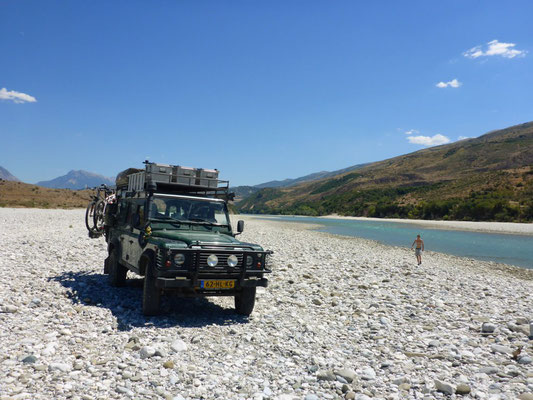 Time for a dive in the river while the Defender 110 waits for us