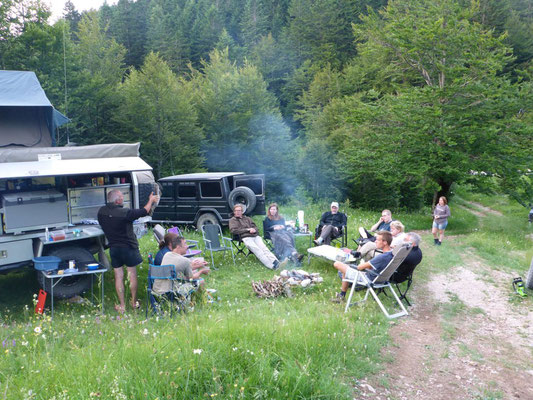 Overlander camp with a fireplace, having a good time together