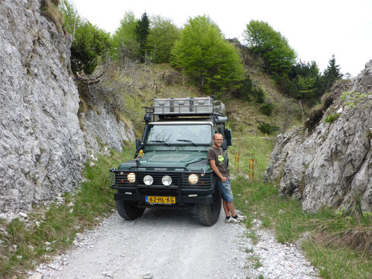 Land Rover Defender and me driving over a mountain pass near Lake Garda.