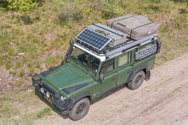 Land Rover Defender Camper overview with solar panel