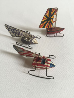 Three Ice Racers  ca. 1962  Eraser, paper clips, Scotch tape, paint.