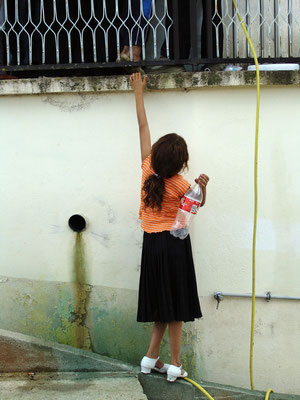 A girl waiting for holy water in Letnica / Viti