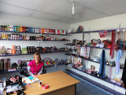 The owner of a newly opened drugstore in her shop