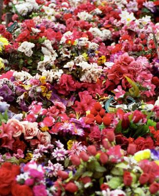 Plastic flowers on a martyrs' graveyard in Landovica / Prizren