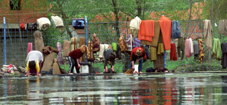 Women washing their clothes in the spa of Malishevo