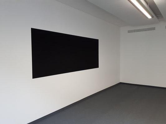 Tafellack-Feld auf weißer Wand