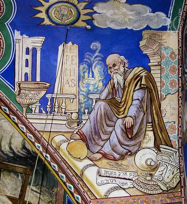 Der verzweifelte Jeremias sitzt in den Ruinen Jerusalems.