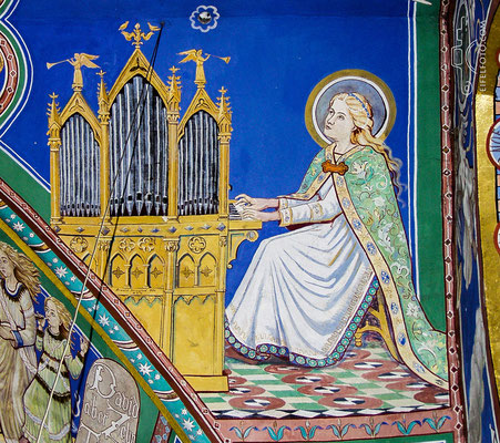 Cäcilia, Schutzpatronin der Kirchenmusik, an der Orgel.