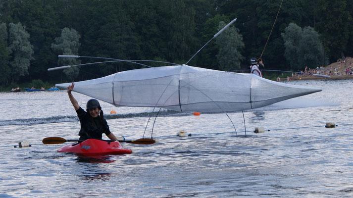"""""""Pond Skater"""",500х200х80 cm, lavsan tape, fiberglass,2012 """"The Raft of the Arts"""", St. Petersburg, creative association Ozerki;"""
