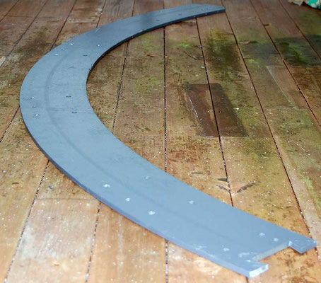 The quarter segment after flattening on a machine press.