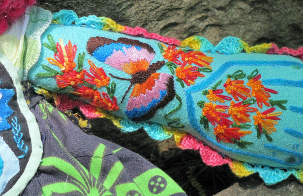 "Panama. Detail of arm. Hand-embroidery and mixed media. 18"" X 15"" X 3"". NFS."