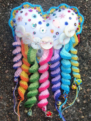 "More Fun In The US. Hand-crochet and mixed media. 10.5"" X 5"" X 1.5"". $125."