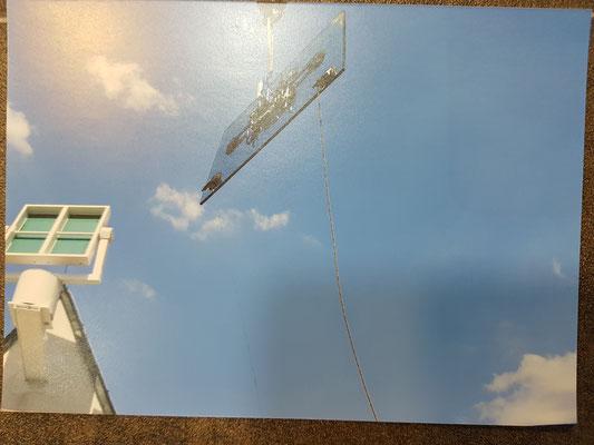 Kran im Einsatz. Glasdachanlage.