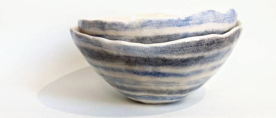 "Unique ""pinchpot"" bowls in white earthenware. Coloured with underglaze pen and non-toxic glazing."