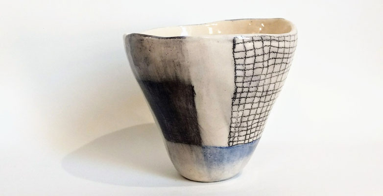 "Unique ""pinchpot"" bowl in white earthenware. Coloured with underglaze pen and non-toxic glazing."