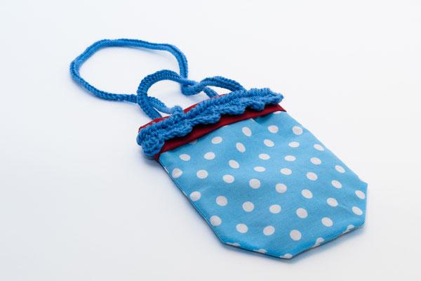 Sac range tétine Pèsols blancs fond bleu avec anses crochetés bleues