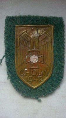 Tarcza za Chołm , wydane 5500 szt. zielony materiał Woj. Ląd, niebieski - lotnictwo, czarny - pancerne