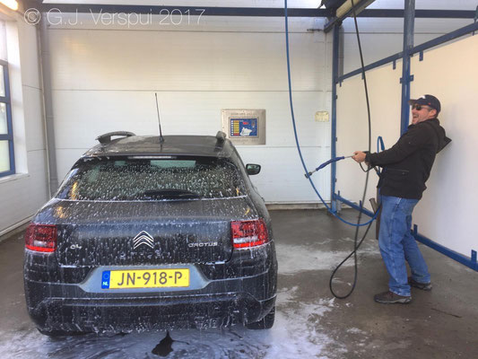 Tim cleaning the car he loves..