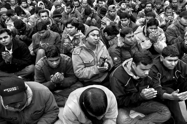 Muslim prayer at early dawn. During the five days and nights of hunger and thirst strike in central San Giovanni's Square.
